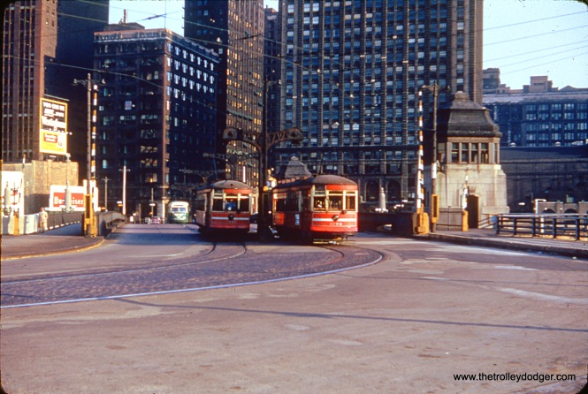 CTA 3173, at right, is a one-man car running on Route 38, as is the red car it is passing. At left is a Route 4 - Cottage Grove prewar PCC. We are looking south on Wabash Avenue, just north of the Chicago River, in the early 1950s.