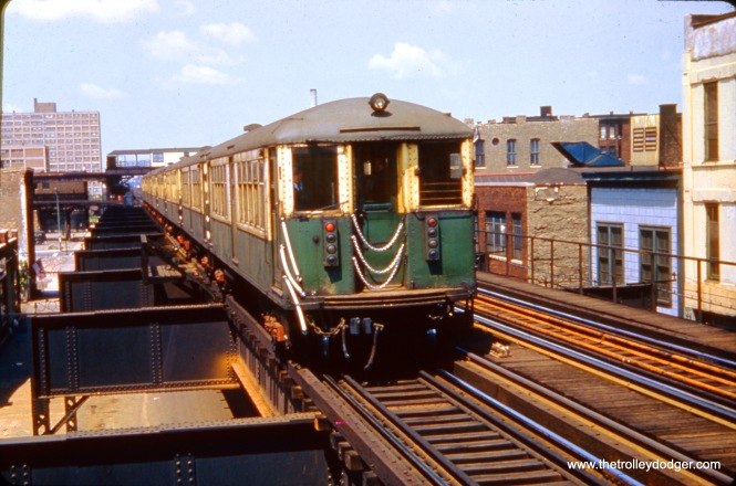 CTA 4095 is eastbound at Lake and Ashland on June 24, 1961. In the ackground, you can see the old Lake Transfer station, where riders could change (up until February 1951) for Logan Square and Humboldt Park trains.