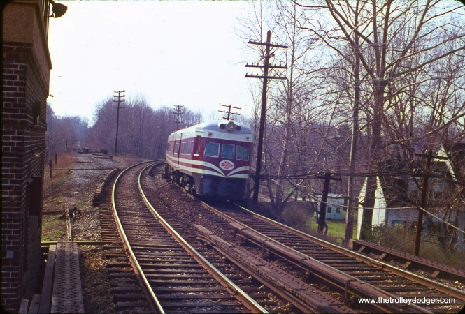 In this April 11, 1964 view, one of the former North Shore Line Electroliners has been rechristened as a Red Arrow Liberty Liner on the Norristown High Speed Line in Philadelphia's suburbs. I would expect that the abandoned right-of-way at left is where the Strafford branch once was.