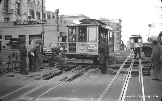 Cable car track work at Powell and California on October 31, 1957.