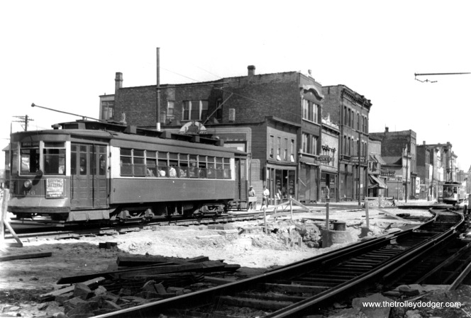 Chicago Surface Lines red Pullman 426 is most likely running on Route 65 - Grand, as it is signed to go to Grand and Armitage. Chances are, this photo was taken circa 1939-40, and shows temporary trackage for construction of Chicago's first subways.
