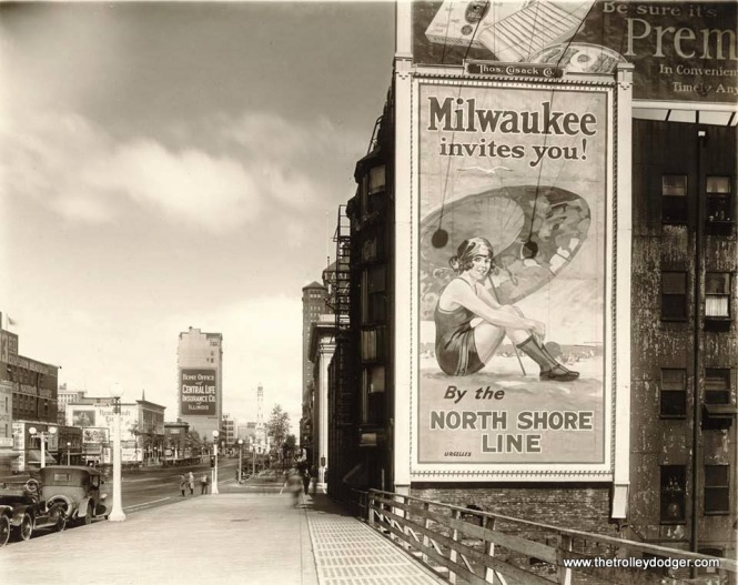 Looking north on Chicago's Michigan Avenue at Ohio Street circa mid-late 1920s. BTW - the billboard on the right was originally produced in 1925 as a South Shore Line one-sheet poster. (J. J. Sedelmaier Collection)