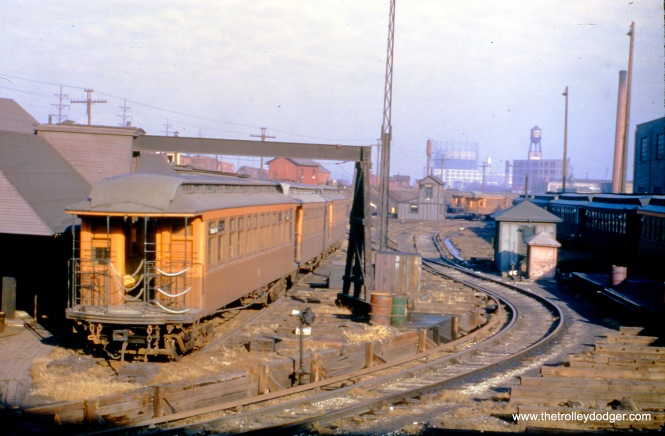CTA gate car 2318 is parked along the outer portion of the Douglas Park line in February 1950.