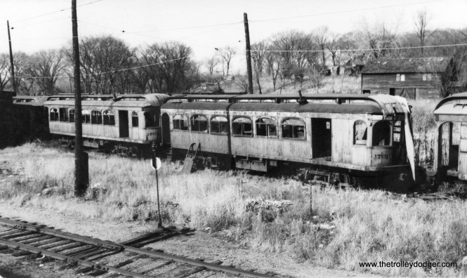 Des Moines and Central Iowa cars #1701 and 1704 in the scrap line, November 19, 1939.