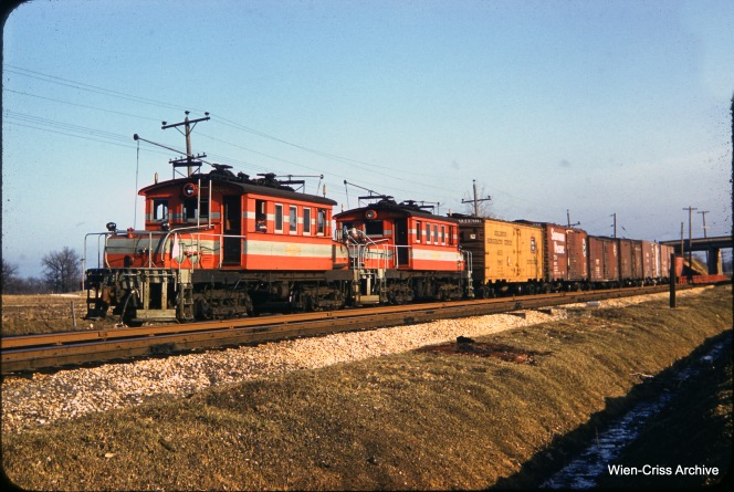 On March 17, 1957 the late James J. Buckley caught this terrific 3/4 view of a Chicago, Aurora & Elgin freight train at Lakewood. (Wien-Criss Archive)