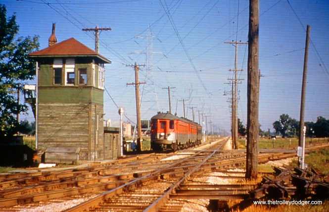 Milwaukee County, WI - In 1958, a southbound CNS&M passenger train approaches the crossing with C&NW