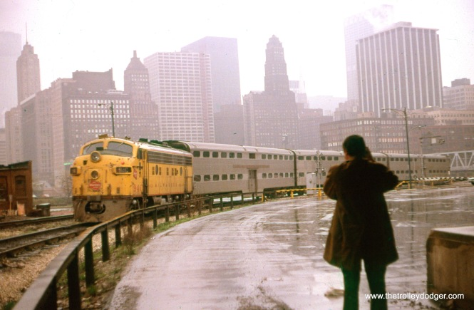 This slide mount has George Strombeck written on it, but I am not sure whether that is the name of the photographer, or the man in the picture. Either way, this shows a Milwaukee Road commuter train in Downtown Chicago on April 21, 1973. (William Shapotkin Collection)