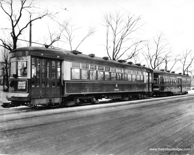 The Chicago Surface Lines used trailers during the 1920s, as a way of dealing with increasing crowds of riders. But with the advent of the Great Depression, ridership fell sharply, and the trailers were no longer needed. Some thought was given to reviving them during World War II, but this did not happen. Here, 1756 pulls 8049. Don's Rail Photos notes,