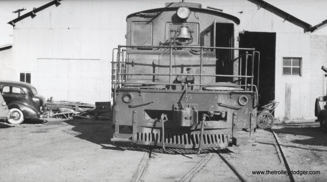 Unidentified steeple cab locomotive.
