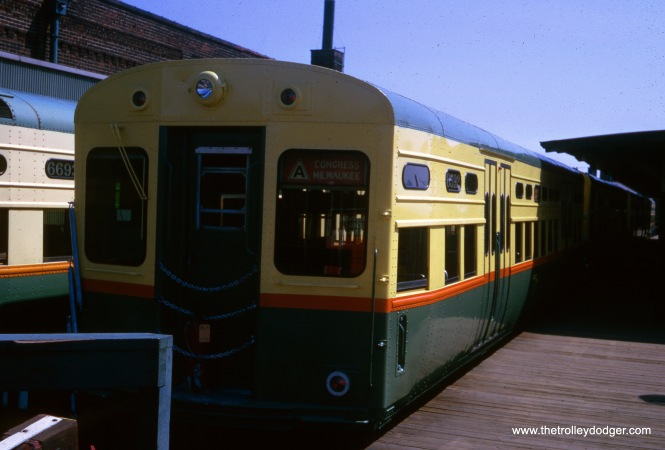 "The tail end of a Congress-Milwaukee ""A"" train at the Logan Square terminal in September 1964. As you can see, space here was at a premium. George Trapp adds, ""Tail end of freshly painted 6592-6591 at Logan Square in Sept. 1964. This set was in builder's photos by St. Louis Car around June 1957. When new were originally assigned to North-South route as were all high 6000's until mid 1960, although some 6600's were on Ravenswood in 1959-60. I always though the old Logan Square terminal was neat, certainly had more character than present one."""