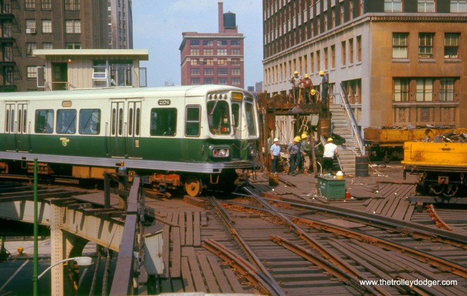 The same basic scene as the last photo, from July 1969. We can tell that this picture was taken prior to the opening of the Dan Ryan line (September 28, 1969) because the train making the turn here is simply signed for Lake. Prior to the through-routing, Lake Street trains went around the Loop, and all traffic went counter-clockwise. The new track connection that allowed bi-directional operation had not yet been installed here.