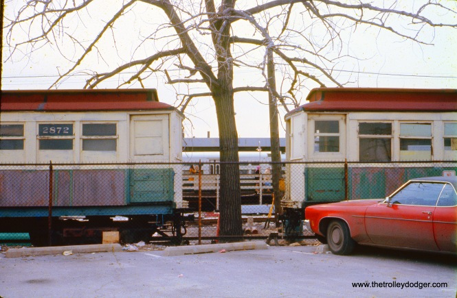 "Here, a couple of old CTA ""Met"" cars are being used as either offices or storage at Kimball Yard in April 1974."