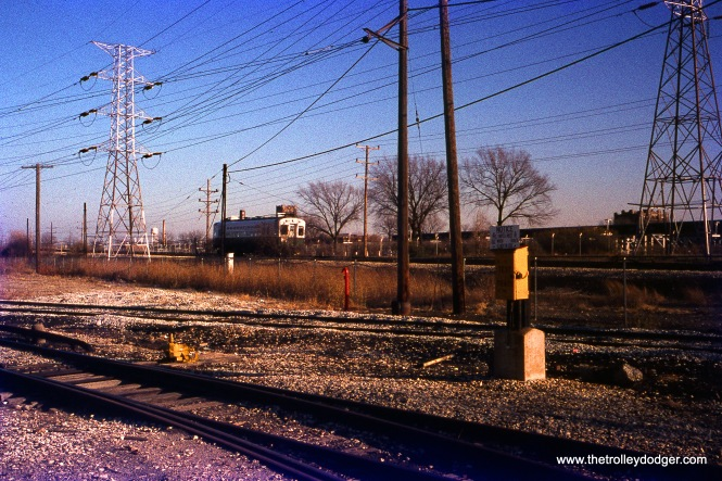 A CTA single-car Skokie Swift train near Skokie Shops on December 11, 1976.