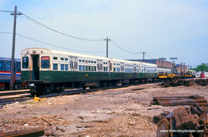 "A CTA work train, powered by 6000-series ""L"" cars, including S-406, at Skokie Shops on May 21, 1977."