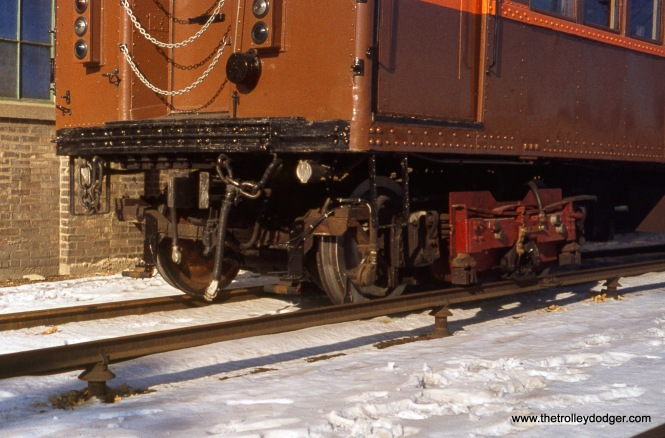 The front trucks of CTA 4271, at Skokie Shops on December 11, 1976.