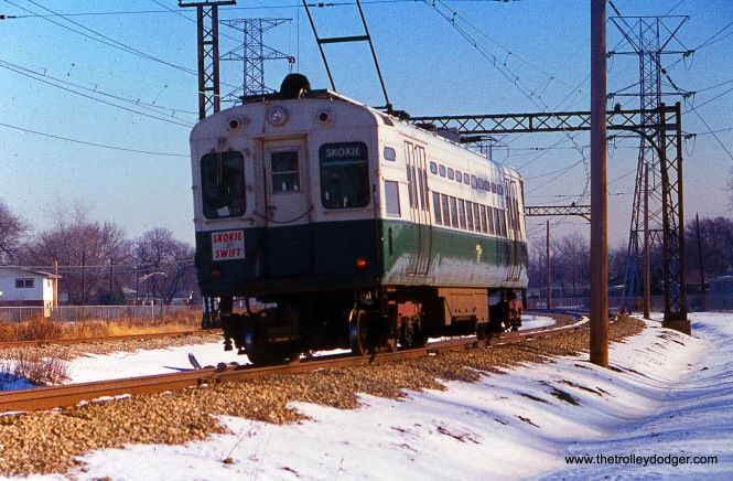 A CTA single-car unit, equipped with an airfoil pan trolley, on the Skokie Swift on December 11, 1976.