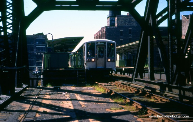 "A train of CTA 2200-series ""L"" cars at Clinton on the Lake branch of the Lake-Dan Ryan line in September 1977. the view looks west."