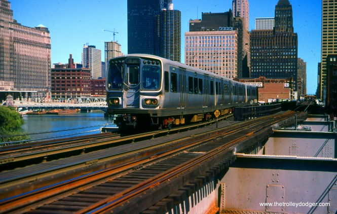 "A train of CTA 2000-series ""L"" cars, running on the Lake-Dan Ryan line, approaches the bridge over the Chicago & North Western in September 1977, heading westbound."