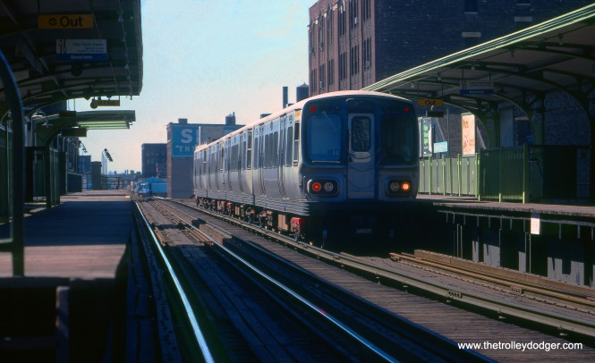 "A train of CTA 2000-series ""L"" cars at Clinton on the Lake Street ""L"" (today's Green Line) in September 1977."
