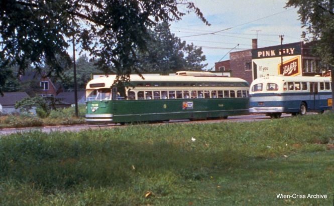 "Here, we see CTA PCC 7236, a postwar product of the St. Louis Car Company. Jeff Wien: ""It is on Western Avenue Avenue during the one man period 1955-56. Because of the grass in the foreground, it seems park-like, which was the case where Western Avenue was paralleled by Western Blvd., which I believe extended from Archer to Garfield. I would guess that the slide is on Western Ave south of Archer."" (Wien-Criss Archive)"