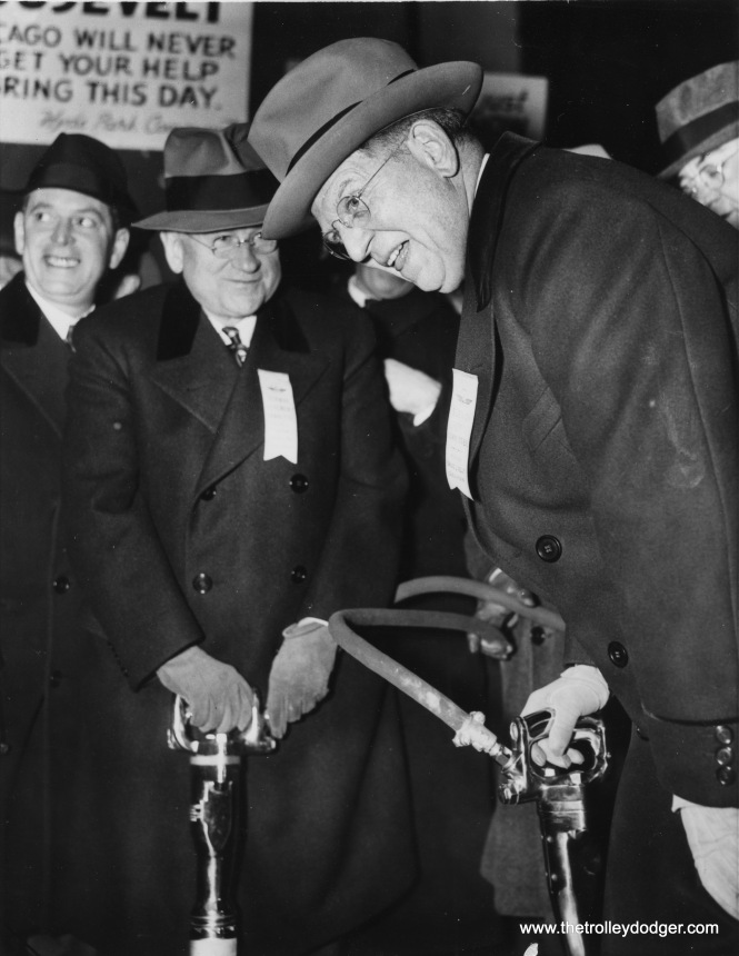 Chicago, Illinois, December 17, 1938-- Secretary Harold Ickes, left, and Mayor Edward J. Kelly turn the first spadeful of earth to start the new $40,000,000 subway project. Many thousands gathered to celebrate the starting of work on the subway.