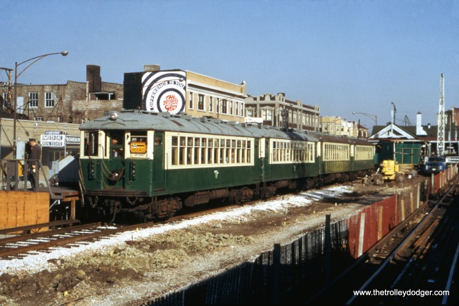 "CTA 4271-4272 head up a Ravenswood ""A"" train leaving Kimball and Lawrence on October 21, 1973. This shows how this pair of cars looked before they were renovated as part of CTA's historical fleet."