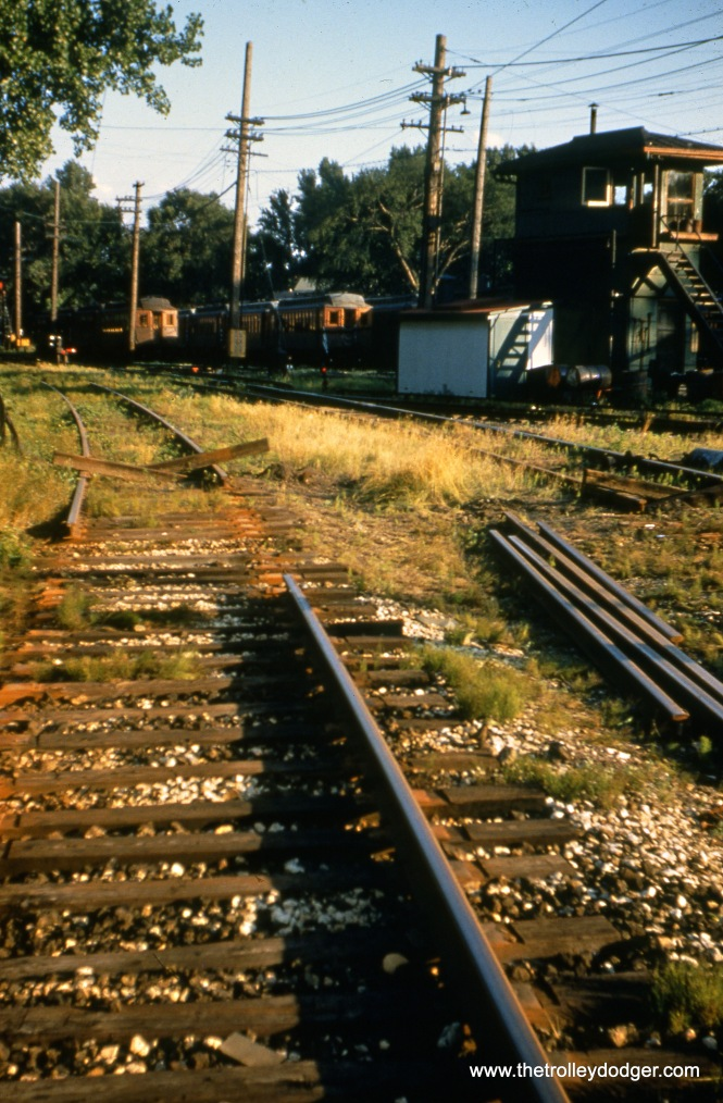 This shows where the North Shore Line interurban tracks connected to the CTA at Linden Avenue in Wilmette, just east of the terminal at the north end of the Evanston branch. Here, on July 25, 1955 the track connection with the CTA has been severed forever, as service on the NSL's Shore Line Route was abandoned the day before. There was one final fantrip on the route this same day.