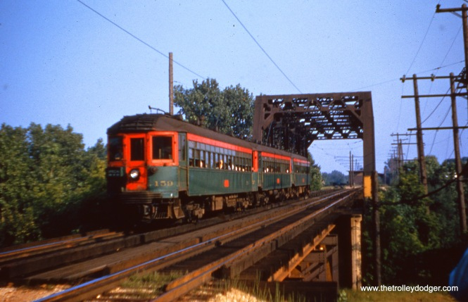 NSL 159 and train crossing a bridge on the Shore Line Route. on July 20, 1955 (Joseph Canfield Photo)