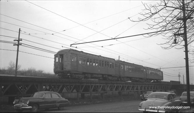 A three-car train of CTA 1700-series RR roof