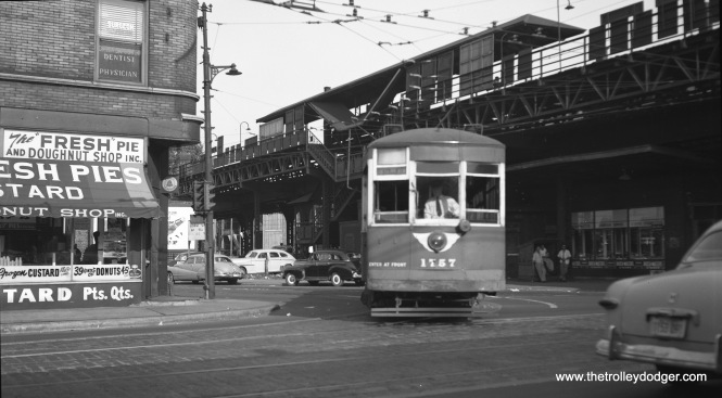 CTA one-man car 1757, turning north onto Pulaski Road from Fifth Avenue (at the west end of the Fifth Avenue line) on July 5, 1953. This is one of the old red cars that the CTA painted green. Notice that the streetcar is turning onto a gauntlet track, so as not to interfere with the northbound and southbound tracks on Pulaski. The Pulaski station on the Garfield Park