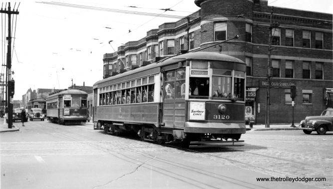 "CSL 3120 on a 1940s charter. Mike adds, ""3120 is at the corner of 79th & Vincennes. The building in the background recently burned down and was demolished."""