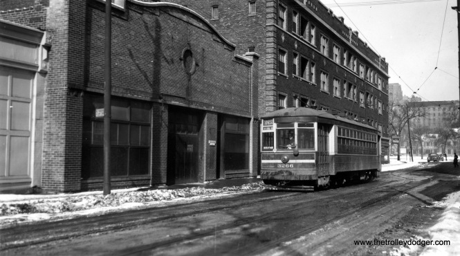 "CSL 3266, running on the 59th-61st Street route. Mike adds, ""3266 is heading south on Blackstone from 60th. The street has been vacated and none of the buildings remain."""