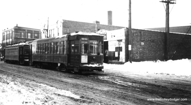 "CSL 3041 at Montrose and Milwaukee (west end of the Montrose line). S. Terman adds, ""Since 3041 brill is a 2 man car, its looks odd as Montrose is 1 man operation unless its a school trip."" Thanks to Steve D. for correcting this location (we had thought it was Montrose and Broadway, which is how the photo was marked, see his Comment.) The view looks northwest. He speculates that there was a delay on Elston, and a two-man car from that line was diverted onto west Montrose."