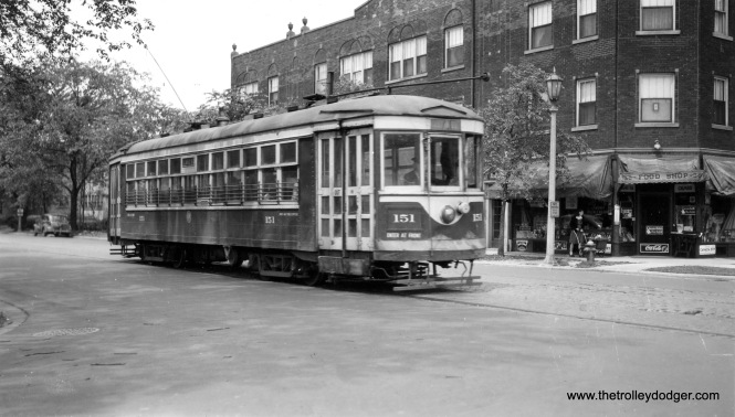 Chicago & West Towns 1151, eastbound on Lake Street in Oak Park, a block away from the end of the line at Austin Boulevard. The building to the north is still standing.