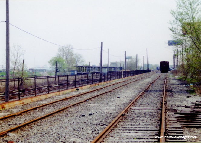 This is a somewhat unusual view, taken along the B&OCT tracks, just west of Central Avenue. At left, you can see the CTA's Central Avenue stop on the Congress line, now the Blue Line. The station closed in 1973 due to lack of ridership. The Eisenhower expressway would be to the left of the station, which was not served by buses, and was the only walkup (other than the Forest Park terminal) on this line, which is almost all in an open cut. We are looking mainly to the east and a bit to the north.