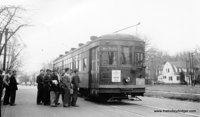 "North Shore Line streetcar 360 is signed for the Naval Station, which makes this Waukegan. Joe Stupar: ""The North Shore Line streetcar 360 looks like it might be at the North end of North Av? The house looks a lot like 416 W Greenwood Av, still there."""
