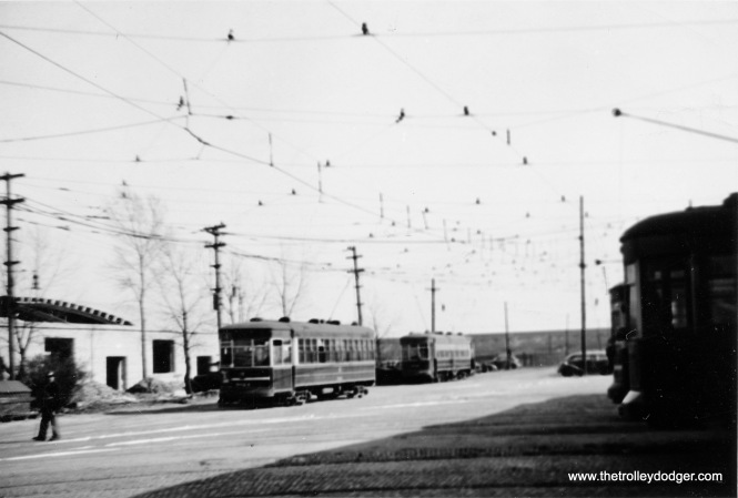 "Not sure where this rather blurry picture of a CSL car barn is. Andre Kristopans: ""The blurry carbarn shot should be Burnside, looking south on Drexel from 93rd."" M.E.: ""I'll hazard a guess this is the carbarn on 93rd at Drexel (900 east). I say this because I think there are railroad cars in the background. A block or so east of the Drexel barn, the 93rd St. car turned right (on Kenwood, I think) to reach a private right-of-way that crossed the railroad at grade level. Altogether an interesting operation."""