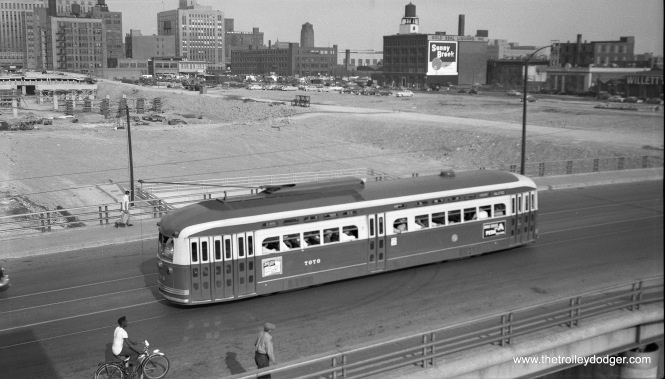 "On June 19, 1953 CTA PCC 7070 heads south on Roue 8 - Halsted, passing by the Congress Expressway construction site. PCCs were soon taken off Halsted, which ended streetcar service the following year using older equipment. This photo was taken from the nearby Halsted ""L"" station, which was not in the expressway footprint. (Robert Selle Photo)"