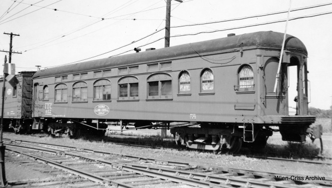 IT 052. This looks like a sleeping car or bunk car and is unpowered.