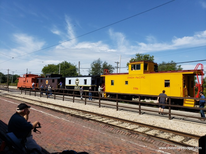 There was a train made up of cabooses for people to ride, powered by a steam engine that is out of this shot. (Is cabooses the plural of caboose? or is it cabeese?)