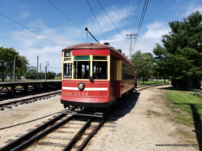 """Chicago Surface Lines streetcar 3142 is part of a series known as """"169"""" or Broadway-State cars. Don's Rail Photos adds, """"3142 was built by Brill Car Co in December 1922, #21686. It was rebuilt as one-man in 1949."""" The white stripe indicated that it was a one-man car, and therefore riders should board at the front, instead of the rear as on a two-man car."""