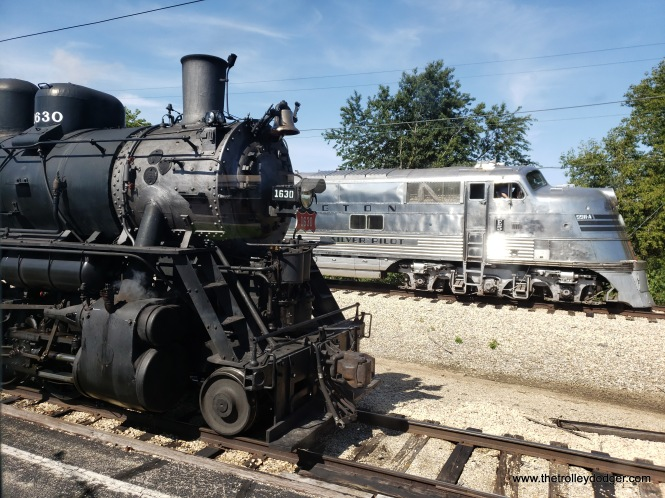 Frisco 1630 steam engine at left, and a Burlington Zephyr diesel at right.