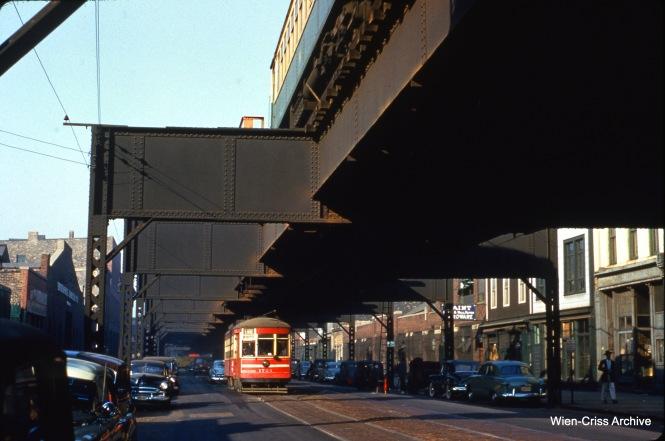 "CTA 1724 on Lake Street at Ashland on October 20, 1953, running under the Lake Street ""L""."