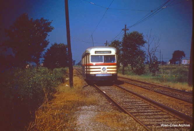 CTA 7012 is westbound on private right of way on 63rd Place and Mobile on August 13, 1950.