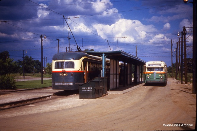CTA 7010 and bus 3677 at 63rd Place and Narragansett on July 1, 1951.