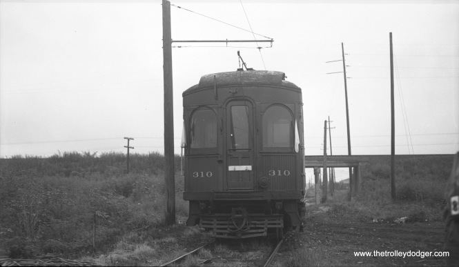 "The caption on this Bob Selle negative reads, ""CERA trip, Sunday morning August 8, 1954. Front view-- Chicago Aurora & Elgin special #310. Secong photo stop on Mt. Carmel branch."""