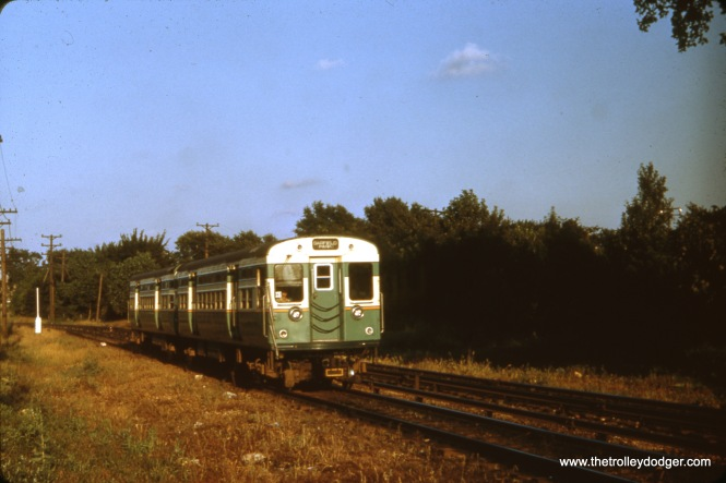 "Here is an example of some early ""flat door"" 6000s running in the 1950s, on the outer portions of the old Garfield Park ""L"". I am not sure whether this picture was taken in Forest Park, just east of DesPlaines Avenue (near where the ""L"" crossed the B&OCT), or along the south edge of Columbus Park a few miles further east."