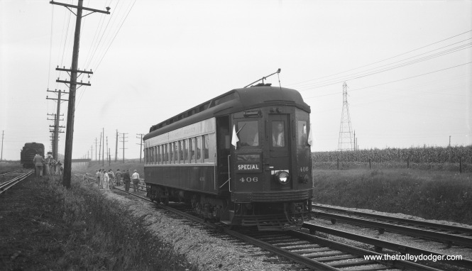 It's August 8, 1954, again on a CERA fantrip, and CA&E car 406 is making a photo stop on the line between Wheaton and Aurora in this Bob Selle view. The way people are walking about along the tracks, with unprotected electric third rail, would never be allowed today for safety and liability reasons.