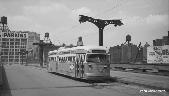 CTA 4238 is southbound on Wabash, crossing the Chicago River. But this must be a reroute, since it is definitely after 1949 (the car has advertising on the side) and it's running Route 36 - Broadway-State. Perhaps there was a parade on State Street that day (between 1939 and 1949 there was no State Street bridge, and this would have been the regular route for 36 then). (Wien-Criss Archive)