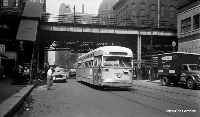 The date at which this photo of CTA PCC 4421 could have been taken, southbound on Clark at Van Buren, is a bit of a mystery. It appears that the street has already been made a one-way, which did not happen until November 16, 1953. But by then, the Pullman PCCs were systematically being retired and shipped to St. Louis, where they were scrapped and parts were reused in rapid transit cars. In my book Chicago Trolleys (page 107) there is a picture of track work being done at this location on July 17, 1954. So, my best guess is this picture was taken during the summer of 1954. (Wien-Criss Archive)